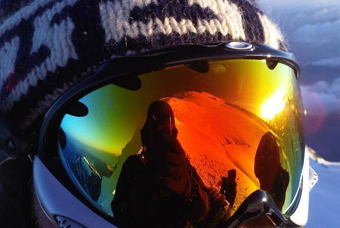 Reflections of Mont Blanc summit in ski goggles