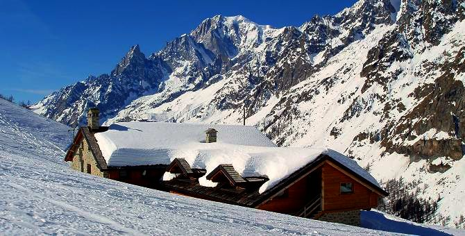 The amazing location of the luxury Bonatti Hut in the Val Ferret with Mont Blanc behind