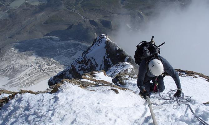 Ascending the fixed ropes above the shoulder of the Matterhorn